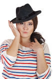 Buxomy serious girl with a hat Royalty Free Stock Photos