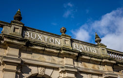Buxton Thermal Baths. Ornate stone sign above the Buxton Thermal Baths. The Thermal baths were designed by Henry Currey, the Duke of Devonshire's architect, in Royalty Free Stock Images