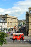Buxton tour bus in the town centre. Buxton tour bus taking tourists around the centre of Buxton town Stock Photos