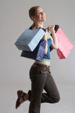 Buy. A girl with shopping bags Stock Images