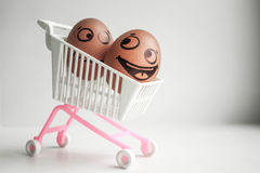 Buy basket concept. An egg with a painted face Royalty Free Stock Photography