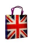 Buy British. Backlit British flag (Union Jack) shopping bag promoting buy British. White background stock images
