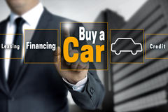 Buy a car touchscreen is operated by businessman