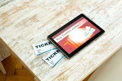 Buy Cinema Tickets online with a Tablet PC Royalty Free Stock Photos