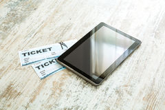 Buy Cinema Tickets online with a Tablet PC Royalty Free Stock Image