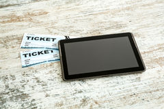 Buy Cinema Tickets online with a Tablet PC Stock Image