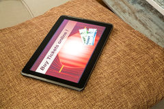 Buy Cinema Tickets online with a Tablet PC Royalty Free Stock Photo