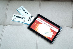 Buy Cinema Tickets online with a Tablet PC Stock Photo