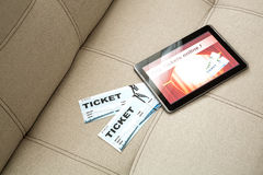 Buy Cinema Tickets online with a Tablet PC Royalty Free Stock Photography