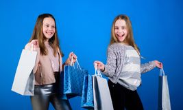 Buy clothes. Fashionista addicted buyer. Fashion boutique kids. Shopping of her dreams. Happy children in shop with bags. Shopping is best therapy. Shopping stock image