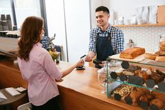 Buy Coffee. Woman Paying With Credit Card In Cafe Stock Images