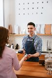 Buy Coffee. Woman Paying With Credit Card In Cafe Stock Photos