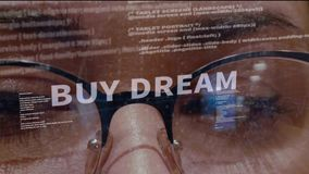 Buy dream text on background of developer. Buy dream text on the background of female software developer. Eyes of woman with glasses are looking at programming stock footage