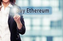 Buy Ethereum. Businesswoman pressing Buy Ethereum button at her office. Cryptocurrency concept stock image