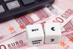 Buy Euro. Euro currency with calculator and dice showing BUY Stock Photography