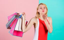Buy everything you want. Girl satisfied with shopping. Tips to shop sales successfully. Girl enjoy shopping or just got. Birthday gifts. Woman red dress hold stock photo