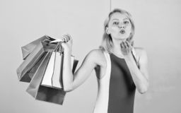 Buy everything you want. Girl satisfied with shopping. Tips to shop sales successfully. Girl enjoy shopping or just got. Birthday gifts. Woman red dress hold stock images