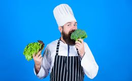 Buy fresh vegetables grocery store. Vegan restaurant. Hipster chief chef vegan cafe. Health and dieting. I choose vegan. Lifestyle. Man cook hat apron hold stock photos