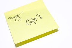 Buy gift. It is a close shot of a memo paper Royalty Free Stock Images