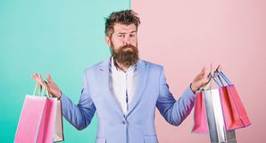 Buy gifts in advance. Enjoy shopping black friday. Hipster shopping with discount. Man bearded hipster businessman stock images