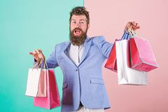 Buy gifts in advance. Enjoy shopping black friday. Hipster shopping with discount. Man bearded hipster businessman royalty free stock photography
