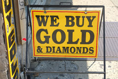 We Buy Gold. A yellow sign that reads We buy gold and diamonds royalty free stock photos