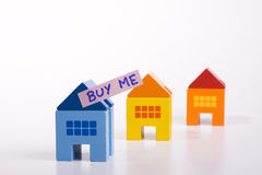 Buy this house. A toy house with a ad saying Buy Me stock images