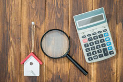 Buy house Mortgage calculations,  calculator with Magnifier Royalty Free Stock Photos