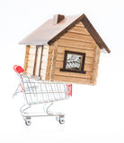 Buy house. House sold bought in red shopping cart trolley on white Royalty Free Stock Photos