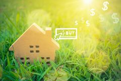 Buy icon screen on model of a little house. royalty free stock images