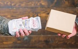 Free Buy Illegal Products. Cash Money And Box With Forbidden Goods Exchange. Illegal Deal Concept. Money Cash In Hand Of Royalty Free Stock Photography - 146557467