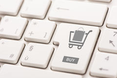 Buy key showing internet commerce or online shop concept Stock Image