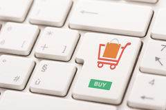 Buy key showing internet commerce or online shop concept Royalty Free Stock Photography