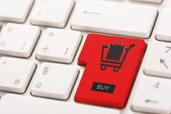 Buy key showing internet commerce or online shop concept Stock Photos