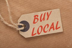 Buy Local Price Tag. Advice to Buy Local printed on a brown paper price tag as a means of supporting local suppliers and producers Royalty Free Stock Image