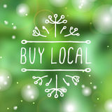 Buy local - product label on blurred background Stock Photography