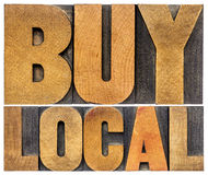 Buy local words in wood type. Buy local words  - isolated in vintage letterpress wood type Royalty Free Stock Photos
