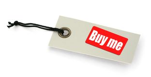 BUY ME tag. Close-up of a BUY ME tag against white, gentle shadow in front, no copyright infringement Stock Photos