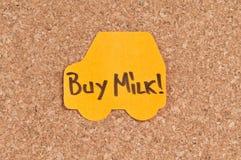 Buy Milk. Written on a sticky note Stock Photos