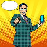 Buy a new gadget and phone business concept. Pop art retro style. Businessman touts smartphone Royalty Free Stock Photos