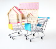 Buy a new house. House in shopping cart Stock Photos