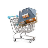 Buy new real estate concept, house in a shopping cart Royalty Free Stock Photo