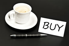 Buy noted on desk with coffee Royalty Free Stock Photos