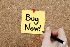 Buy Now. Hand writing Buy Now note stock photos