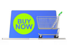 Buy now on laptop computer with cart Royalty Free Stock Image