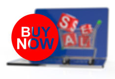 Buy now on laptop computer with cart Stock Photo