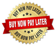 Buy now pay later 3d gold badge. With red ribbon Royalty Free Stock Photo