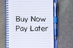 Buy now pay later text concept on notebook Royalty Free Stock Photos