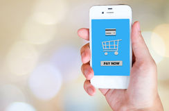 Buy now on smart phone screen in hand, e-business concept Royalty Free Stock Images