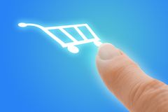 Buy Now Touch Screen Finger Pointing to Shopping C royalty free stock images